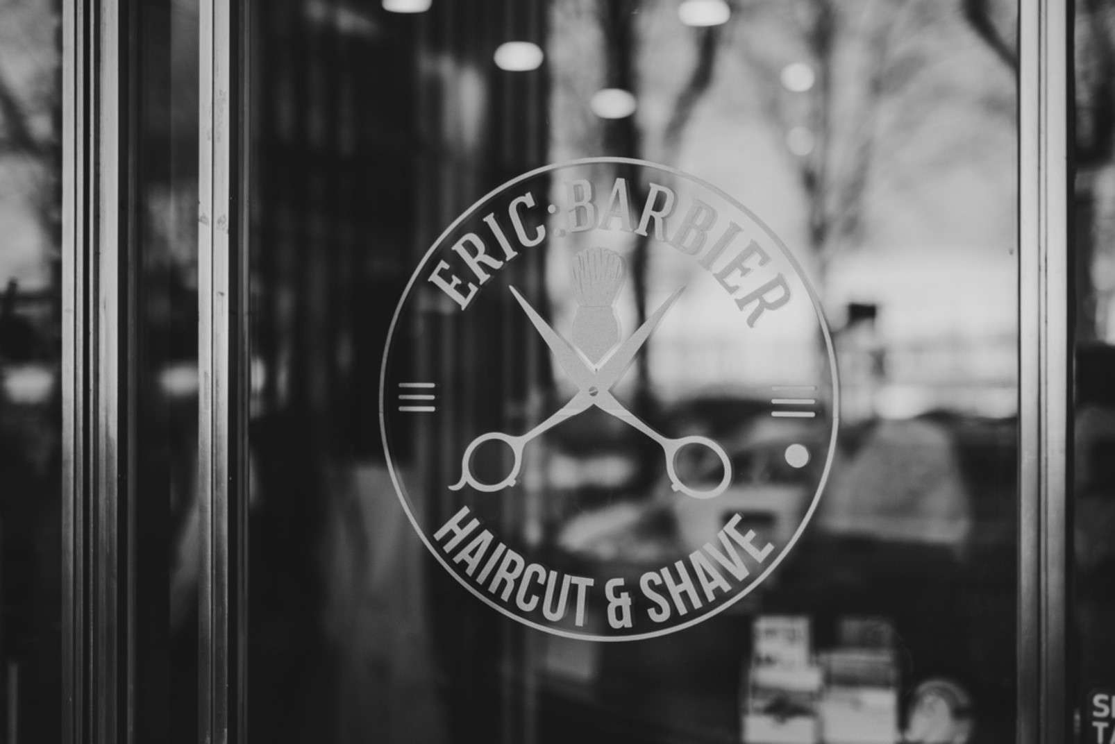 Eric:Barbier Haircut and Shave Hamburg window sticker